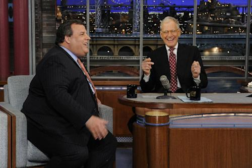 "In this photo released by CBS Broadcasting, New Jersey Gov. Chris Christie, left, and late night host David Letterman, right, react with laughter during the Governor's first visit to CBS' ""Late Show with David Letterman,"" on Monday, Feb. 4, 2013 in New York. (AP Photo/CBS Broadcasting, Jeffrey Neira)"
