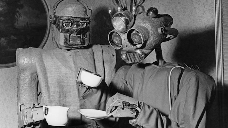 Two robots designed by Viennese artist Claus Scholz `enjoy` a coffee break in 1964