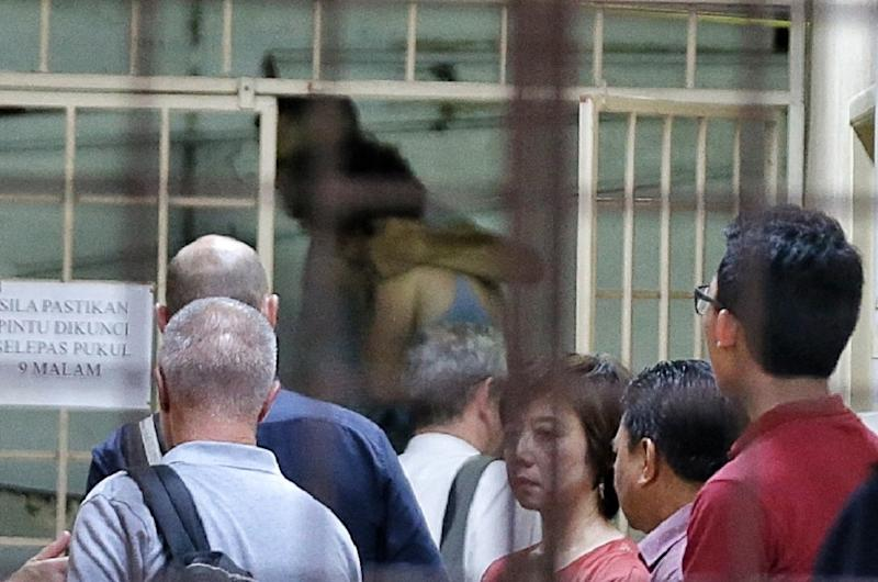 Meabh Quoirin (far back) being consoled by her husband Sebastian Quoirin as they leave the hospital after identifying the body of their daughter Nora Anne at the Forensic Department in Hospital Tuanku Jaafar August 13, 2019. — Picture by Ahmad Zamzahuri