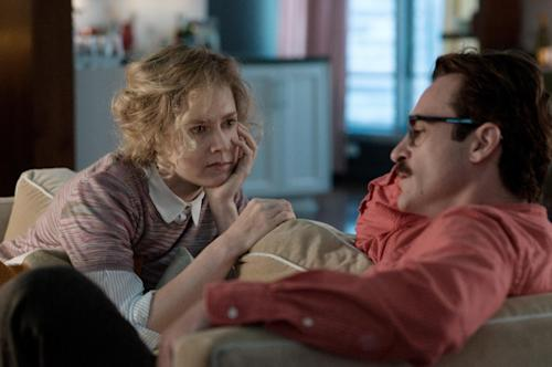 "This image released by Warner Bros. Pictures shows Amy Adams, left, and Joaquin Phoenix in a scene from ""Her."" (AP Photo/Warner Bros. Pictures, Merrick Morton)"