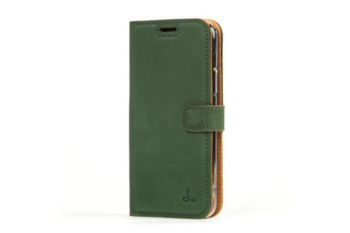 Photo shows the iPhone 11 Pro in a bottle green vintage leather wallet from Snakehive