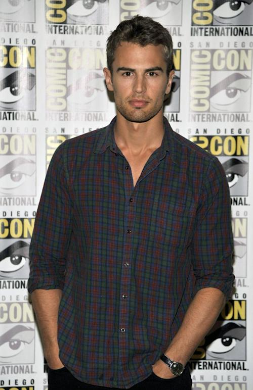 """Theo James attends the """"Divergent"""" press line on Day 2 of Comic-Con International on Thursday, July 18, 2013 in San Diego, Calif. (Photo by Chris Pizzello/Invision/AP)"""