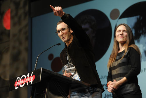 "Jesse Moss, director of ""The Overnighters,"" accepts the U.S. Documentary Special Jury Award for Intuitive Filmmaking alongside his wife Amanda, a producer on the film, during the 2014 Sundance Film Festival Awards Ceremony on Saturday, Jan. 25, 2014, in Park City, Utah. (Photo by Chris Pizzello/Invision/AP)"