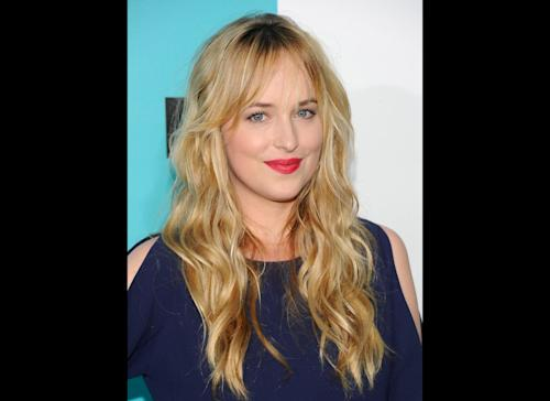 """FILE - Dakota Johnson attends the FOX network upfront presentation party at Wollman Rink, in New York in a May 14, 2012 file photo. Focus Features and Universal Pictures announced Monday, Sept. 2, 2013 that Dakota Johnson will play Anastasia Steele in the big-screen adaptation of E L James' """"Fifty Shades of Grey."""" Johnson is the daughter of actors Don Johnson and Melanie Griffith. (AP Photo/Evan Agostini, File)"""