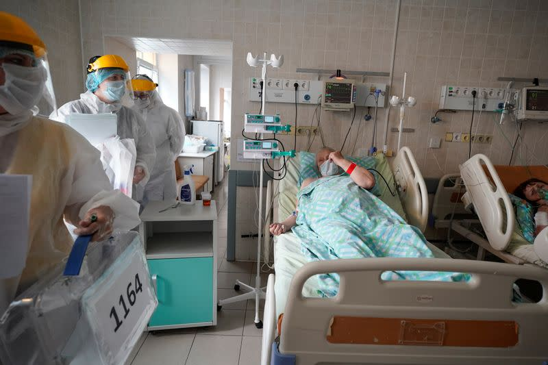 Members of an electoral commission visit a regional hospital during a nationwide vote on constitutional reforms in Tver