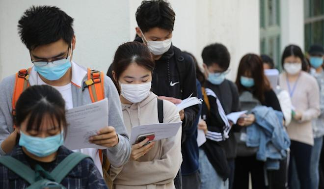 Secondary school students wait to take the DSE exam at the Hong Kong Sze Yap Commercial and Industrial Association Wong Tai Shan Memorial College in Shek Kip Mei in April. Photo: Winson Wong