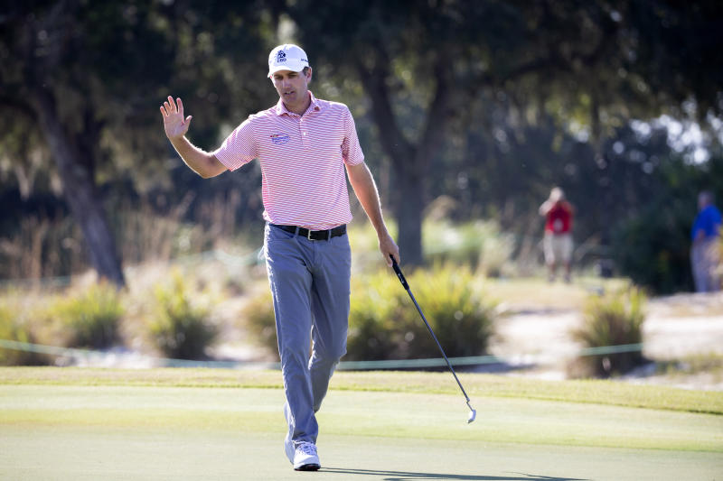 Brendon Todd waves to the crowd after sinking a birdie putt on the first hole during the third round of the RSM Classic golf tournament in St. Simons Island, Ga., Saturday, Nov., 23, 2019. (AP Photo/Stephen B. Morton)