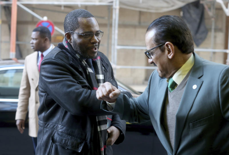 Equatorial Guinea's Mines and Hydrocarbons Minister Gabriel Mbaga Obiang Lima, left, greets an employee of OPEC with his elbow during his arrival for a meeting of the Organization of the Petroleum Exporting Countries, OPEC, at their headquarters in Vienna, Austria, Thursday, March 5, 2020. (AP Photo/Ronald Zak)