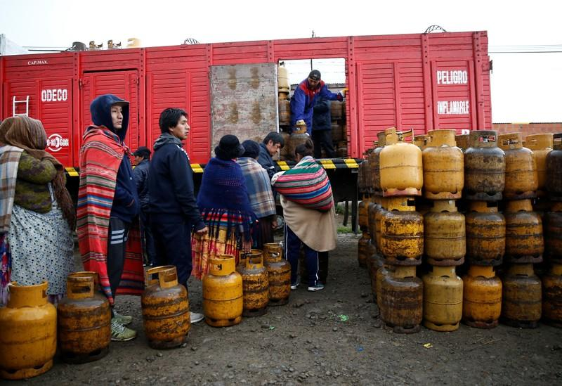 People line up to get a gas cylinder near petrol plant of Senkata, that normalizes fuel distribution in El Alto outskirts of La Paz