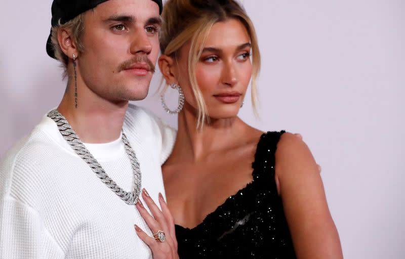 """FILE PHOTO: Singer Bieber and his wife Hailey Baldwin pose at the premiere for the documentary television series """"Justin Bieber: Seasons"""" in Los Angeles"""