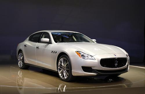 FILE - In this Jan. 14, 2013 file photo, the 2014 Maserati Quattroporte debuts at media previews for the North American International Auto Show in Detroit. The Quattroporte sedan is longer and lighter than before, but still has Maserati's distinctive oval grille and elegant, minimalist styling. (AP Photo/Paul Sancya, File)