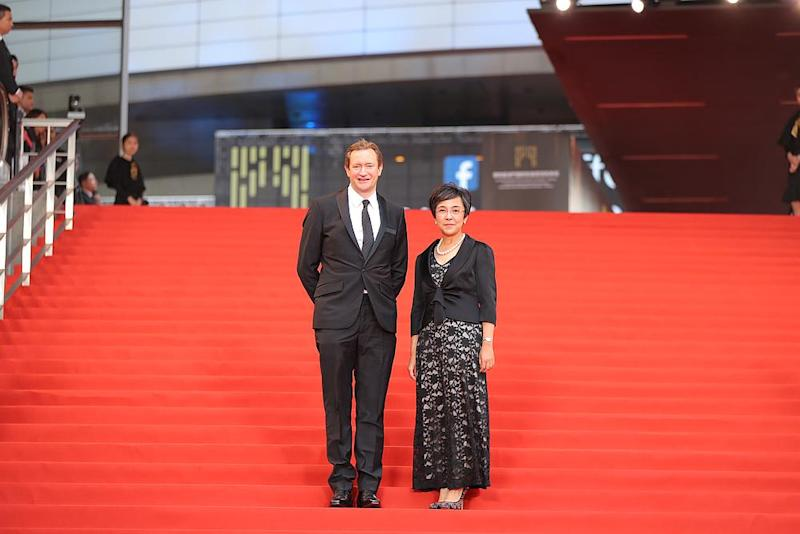 Macao Government Tourism Office director Maria Helena de Senna Fernandes and Iffam artistic director Mike Goodridge on the red carpet. — Picture courtesy of Iffam
