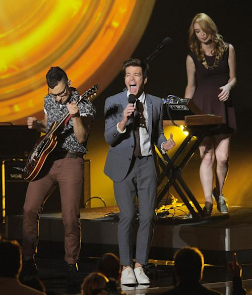 """FILE - In this Aug. 14, 2012 file photo, fun. members, from left, Jack Antonoff, Nate Ruess and Emily Moore perform onstage at the """"Teachers Rock"""" concert at the Nokia Theatre, in Los Angeles. The band is up for six Grammy Awards, including the top four categories: album, song and record of the year, and best new artist. Their current tour wraps in Nashville, Tenn., on Feb. 16, 2013. (Photo by Chris Pizzello/Invision/AP, File)"""