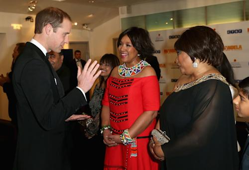 Britain's Prince William, Duke of Cambridge, meets Zindzi Mandela, right, the daughter of former South African President, Nelson Mandela, as they attend the Royal Film Performance of Mandela: Long Walk to Freedom, at the Odeon Leicester Square, London. South African President, Jacob Zuma, announced the death of former South African President Nelson Mandela, to the media Thursday evening Dec. 5, 2013, in South Africa. (AP Photo/Chris Jackson, Pool)