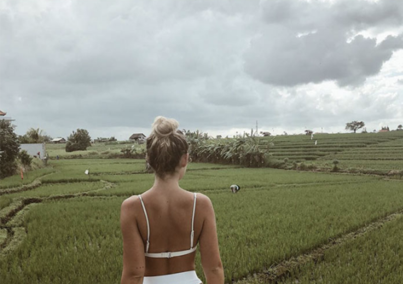 Social media influencer Natalie Schlater posed in a rice field wearing a bikini and mused about life as a field worker in Bali.