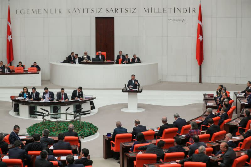 Turkish lawmakers vote a bill that allows troop deployment to Libya, at the Parliament in Ankara