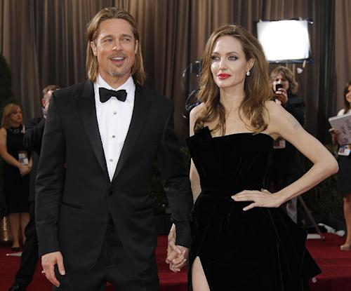 FILE - This Feb. 26, 2012 file photo shows actress Angelina Jolie, right, and actor Brad Pitt at the 84th Academy Awards in the Hollywood section of Los Angeles. Jolie and Pitt are among a number of celebrity couples who vowed not to marry until gay marriage was legal. (AP Photo/Amy Sancetta, File)