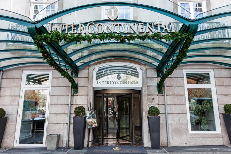Porto, Portugal - January 5, 2015: Entrance of the Palacio das Cardosas Intercontinental Hotel facing the Aliados Avenue and Liberdade Square. A five stars hotel.