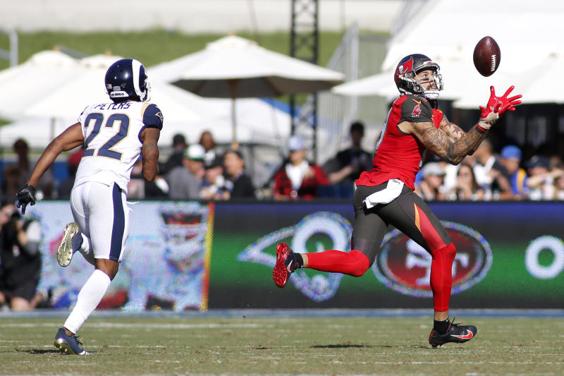 Wide receiver Mike Evans #13 of the Tampa Bay Buccaneers catches a long touchdown pass against the Rams. (Getty Images)