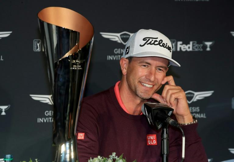 Adam Scott sits beside the trophy after his two-shot win in the Genesis Invitational at The Riviera Country Club on Sunday