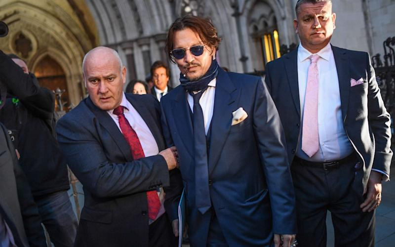 Johnny Depp is seen leaving the Royal Courts of Justice in February - Getty