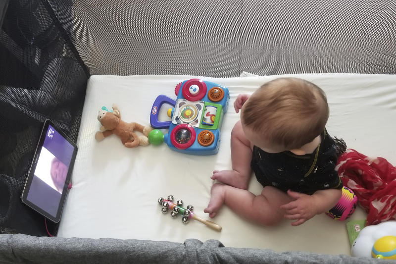 In this March 19, 2020, photo provided by Julie Bufkin, her 7-month-old boy, Calvin, interacts with his grandmother, Debbie Cameron, in Chandler, Ariz., on a FaceTime call from his crib in Tempe, Ariz. The Camerons are among the grandparents all over the country going through a piercing distance from their loved ones for their own protection during the coronavirus crisis. (Julie Bufkin via AP)