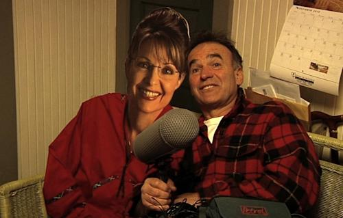 """In this film image released by the Freestyle Releasing, director Nick Broomfield poses with a cardboard cut-out of former Republican Vice Presidential candidate Sarah Palin in a scene from the documentary """"Sarah Palin: You Betcha!"""" The film is being presented at the Toronto International Film Festival. (AP Photo/ Freestyle Releasing)"""