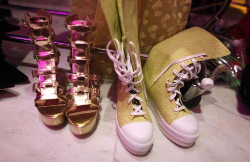 High heels and boots sit next to one another backstage before the Betsey Johnson Spring 2013 collection show during Fashion Week, Tuesday, Sept. 11, 2012, in New York. (AP Photo/Jason DeCrow)