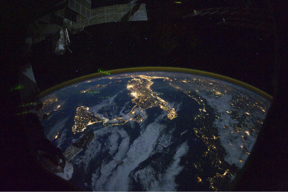 "This image provided by NASA shows parts of Europe and Africa very easily recognizable in this night time image shot by one of the Expedition 25 crew members aboard the International Space Station flying 220 miles above Earth on Thursday Oct. 28, 2010. The view ""looks"" northward over Sicily and the ""boot"" of Italy, with the Mediterranean Sea representing most of the visible water in the view and the Adriatic Sea to the right of center. Tunisia is partially visible at left. Part of a docked Russian spacecraft and other components of the ISS are in the foreground. (AP photo/NASA)"