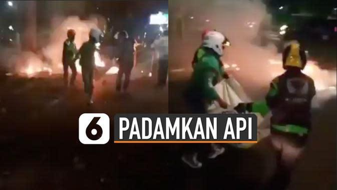 VIDEO: Viral Driver Ojol Padamkan Api Demo