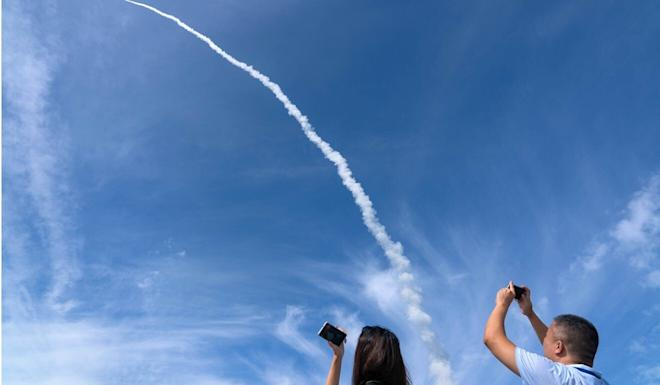 A Chinese rocket launched from a sea base carried nine satellites into space on Tuesday. Photo: Xinhua