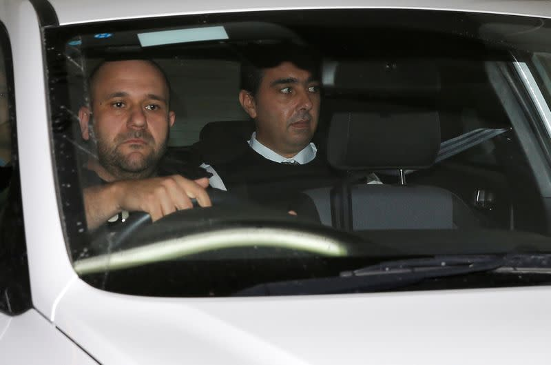 Melvin Theuma, who allegedly acted as a middle man in a plot to murder of journalist Daphne Caruana Galizia, is seen in a police car as he leaves the Courts of Justice in Valletta