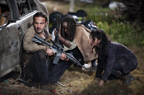 "This publicity photo released by AMC shows, from left, Andrew Lincoln as Rick Grimes, Danai Gurira as Michonne and Melissa Ponzio as Karen, in a scene from Episode 16, ""Welcome to the Tombs"" from Season 3 of ""The Walking Dead."" (AP Photo/AMC, Gene Page)"