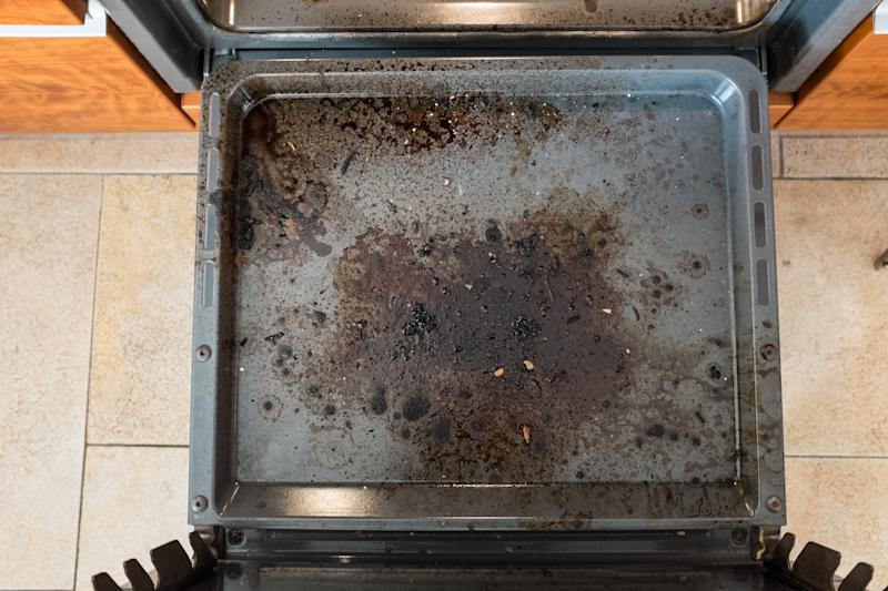 A photo of a dirty kitchen oven from above.