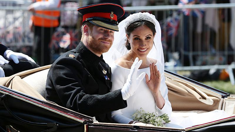 Meghan Markle and Prince Harry in a carraige on their wedding day