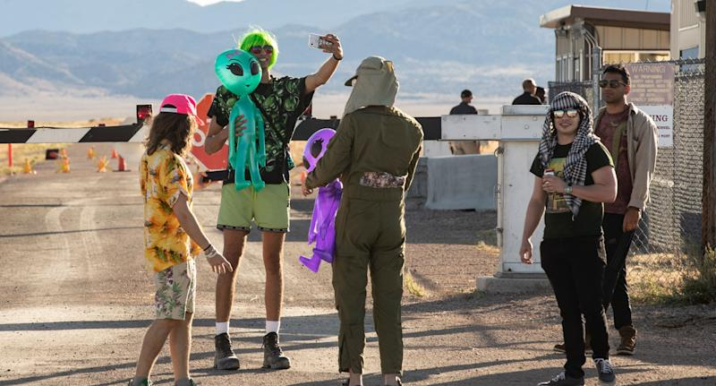 Group of Alien enthusiasts shown at Area 51 site for scheduled raid in the Nevada desert.