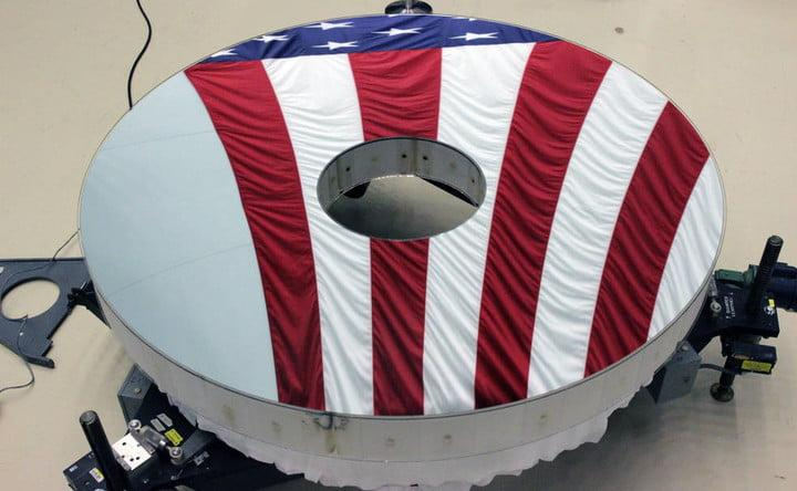 The Roman Space Telescope's primary mirror reflects an American flag. Its surface is figured to a level hundreds of times finer than a typical household mirror.