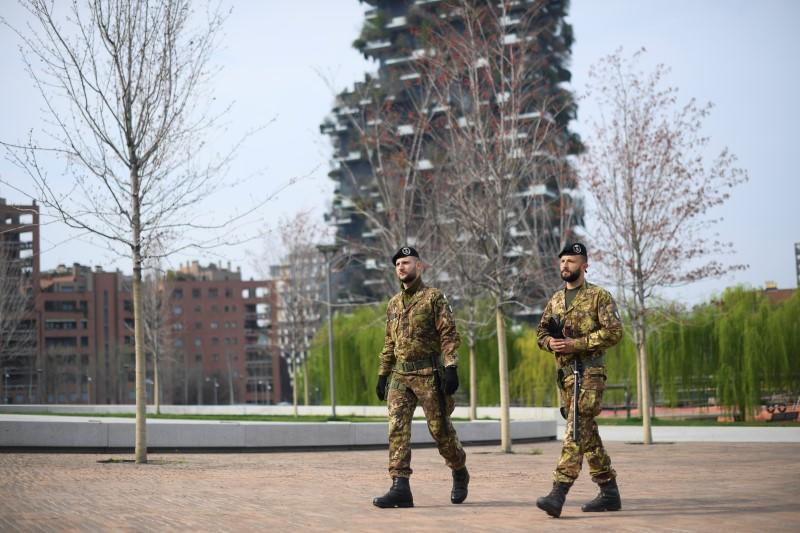 Italian army soldiers patrol streets after being deployed to the region of Lombardy to enforce the lockdown against the spread of coronavirus disease (COVID-19) in Milan