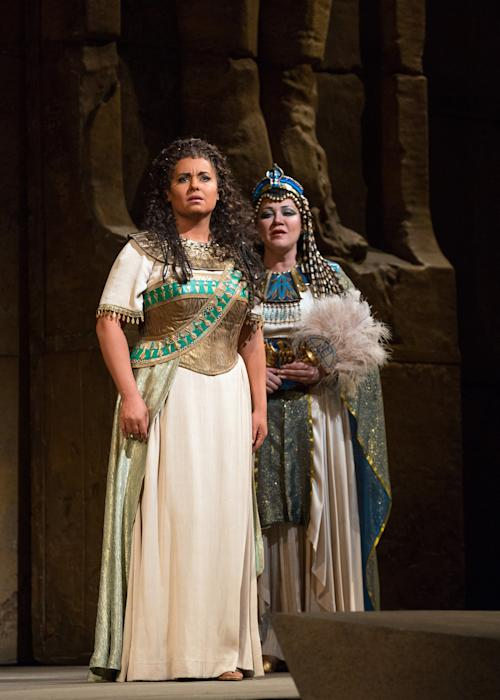 """In this Nov. 15, 2012 photo provided by the Metropolitan Opera, Liudmyla Monastyrska, left, performs in the title role with and Olga Borodina, right, as Amneris in Verdi's """"Aida,"""" during a dress rehearsal at the Metropolitan Opera in New York. (AP Photo/Metropolitan Opera, Marty Sohl)"""