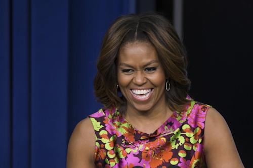 "First lady Michelle Obama laughs as she speaks after a screening of the movie ""The Trip to Bountiful"" Monday, Feb. 24, 2014, in the South Court Auditorium on the White House complex in Washington. (AP Photo/ Evan Vucci)"