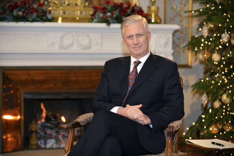 In this photo taken on Monday, Dec. 17, 2018, Belgium's King Philippe poses for a photographer prior to his yearly Christmas message at the Royal Palace in Laeken, Belgium. (Frederic Andrieu/Pool Photo via AP)