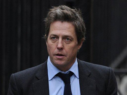 British actor Hugh Grant arrives to attend the Leveson Inquiry in London, The parents of Milly Dowler -- a murdered schoolgirl whose phone was hacked by the News of the World tabloid -- and Grant have given evidence to an inquiry into the standards of the British press