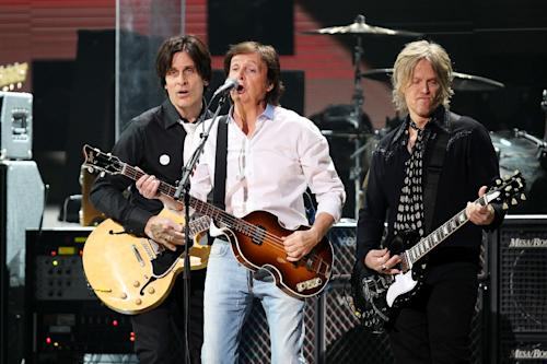 This image released by Starpix shows Paul McCartney, center, at the 12-12-12 The Concert for Sandy Relief at Madison Square Garden in New York on Wednesday, Dec. 12, 2012. Proceeds from the show will be distributed through the Robin Hood Foundation. (AP Photo/Starpix, Dave Allocca)
