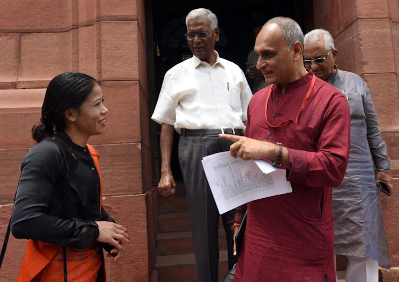 NEW DELHI, INDIA - JULY 16: Rajya Sabha MP Mary Kom talks with BJP MP Rakesh Sinha and CPI MP D Raja during the Budget Session at Parliament complex on July 16, 2019 in New Delhi, India. The Congress party on Tuesday walked out of the Lok Sabha after Speaker Om Birla rejected a notice by its leader Adhir Ranjan Chowdhury over the alleged reports of Chinese troops trying to enter the Indian territory in Jammu and Kashmir on July 6. (Photo by Sonu Mehta/Hindustan Times via Getty Images)