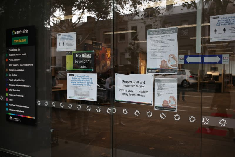 Signs are seen outside a Centrelink office in Sydney