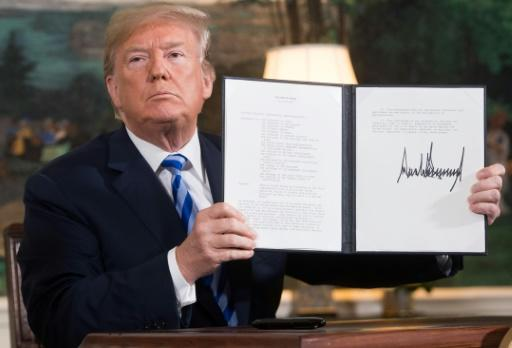 US President Donald Trump signs the document reinstating crippling unilateral sanctions against Iran at the White House on May 8, 2018 after announcing his abandonment of the 2015 nuclear deal
