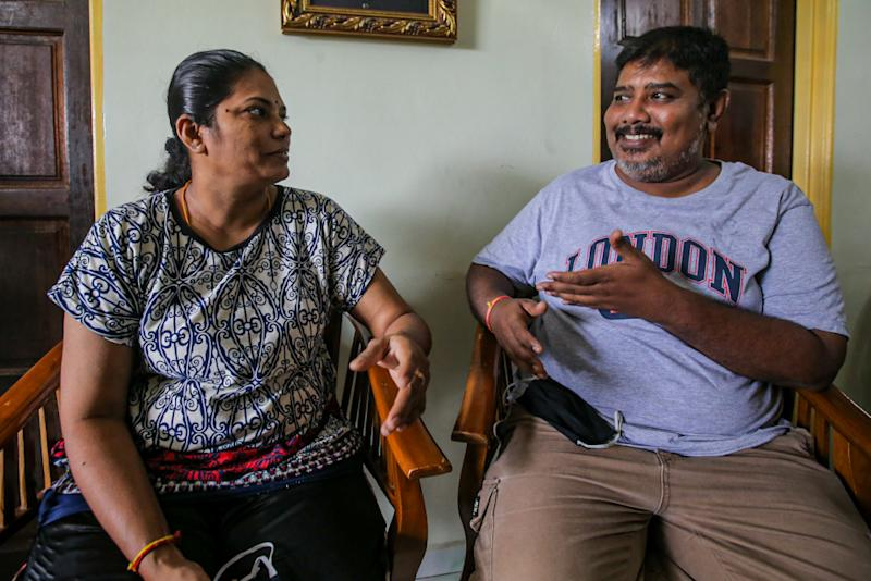 Sumathy Kaliappan (left) and her husband Muruga Marimuthu speak to Malay Mail during an interview at PPR Kerinchi in Kuala Lumpur April 3, 2020. ― Picture by Hari Anggara