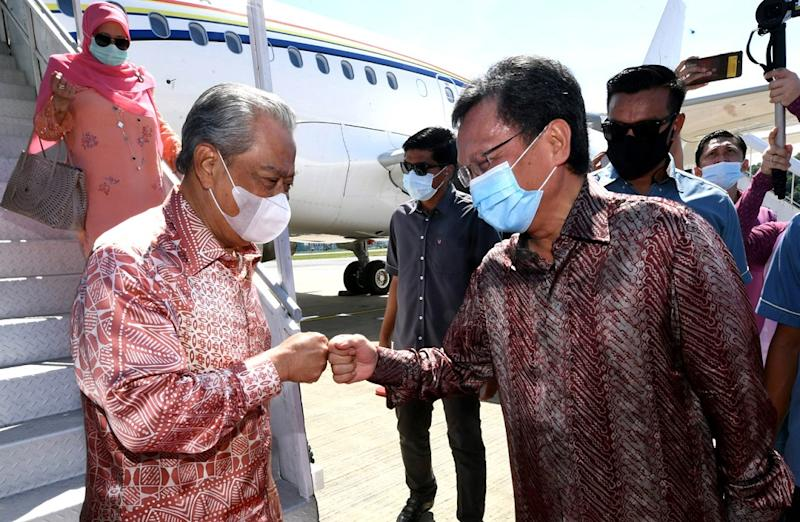 Prime Minister Tan Sri Muhyiddin Yassin was welcomed by Sabah Chief Minister Datuk Seri Mohd Shafie Apdal upon his arrival at the Kota Kinabalu International Airport August 29, 2020. — Bernama pic