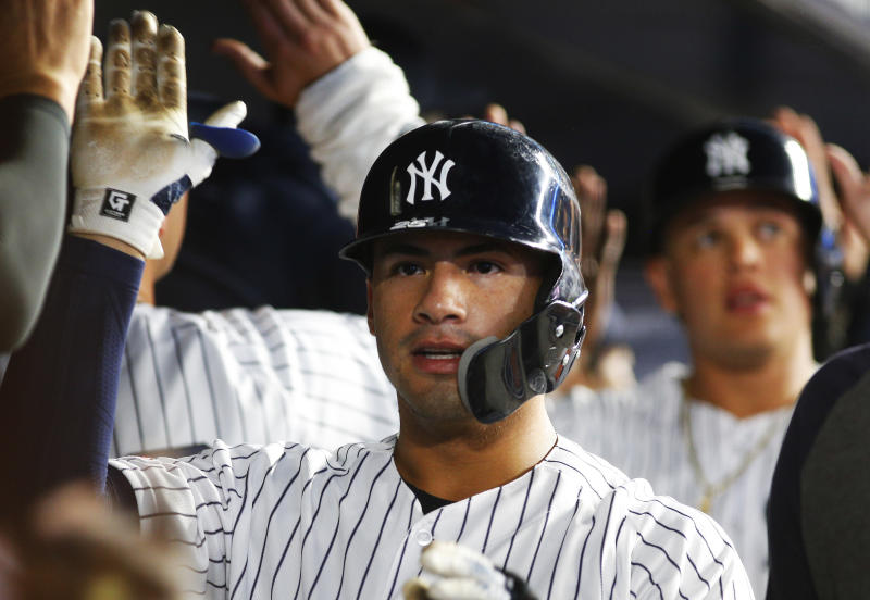 Aug 12, 2019; Bronx, NY, USA; New York Yankees shortstop Gleyber Torres (25) is congratulated after hitting a three run home run against the Baltimore Orioles during the fifth inning of game two of a doubleheader at Yankee Stadium. Mandatory Credit: Andy Marlin-USA TODAY Sports