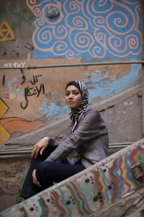 "In this Tuesday, Dec. 10, 2013 photo, Egyptian rapper Myam Mahmoud poses for a portrait in downtown Cairo. Mahmoud, an 18-year-old Egyptian, rapped her way to the semi-finals of the Middle East's hit TV show ""Arabs Got Talent."" While she didn't win the program, Mahmoud did succeed in throwing a spotlight on something more than just herself. On a very public stage, her songs pulled back the curtain on the slew of challenges that women across the Arab world are fighting to overcome. ""I wanted to tell girls in Egypt and everywhere else that they are not alone, we all have the same problems, but we cannot stay silent, we have to speak up,"" Mahmoud told The Associated Press during an interview at her home. (AP Photo/Maya Alleruzzo)"